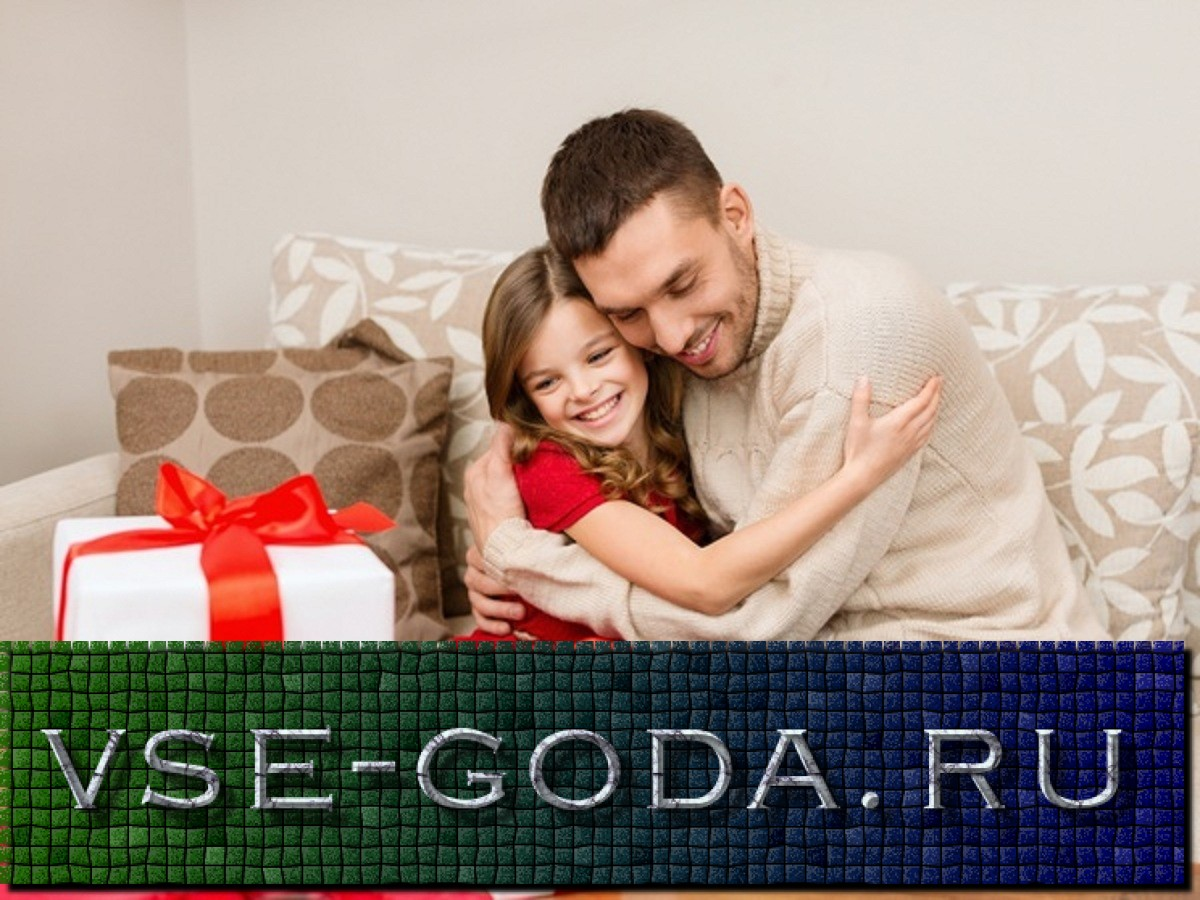 christmas, x-mas, winter, happiness and people concept - smiling father and daughter hugging